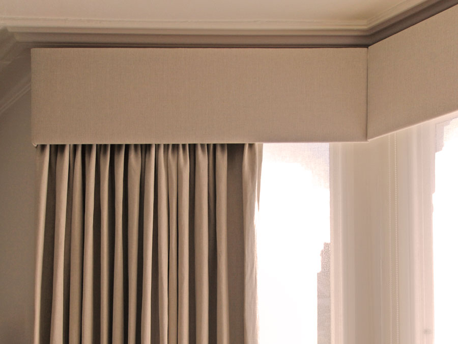 Hard pelmets over curtains keep the heat where you need it